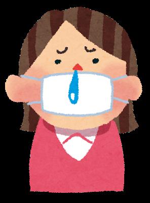 マスクを付けた風邪をひいている女性